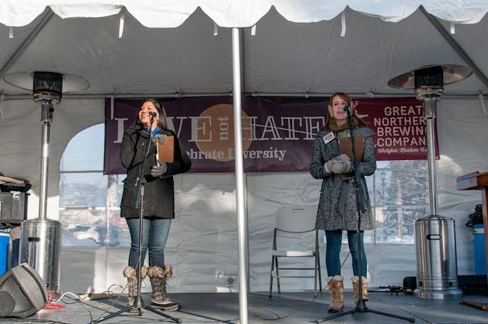 (L to R) Love Not Hate organizers and Whitefish, MT, residents Dominca Kau'ano Cleveras and Jessica Loti Laferriere welcoming the crowd and introducing the speakers at Love Not Hate. (Photo: Lauren Grabelle)