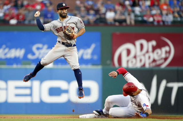 Houston Astros second baseman Jose Altuve, left, starts a double play against Texas Rangers' Joey Gallo to end the the first inning of a baseball game Friday, March 30, 2018, in Arlington, Texas. (AP Photo/Michael Ainsworth)