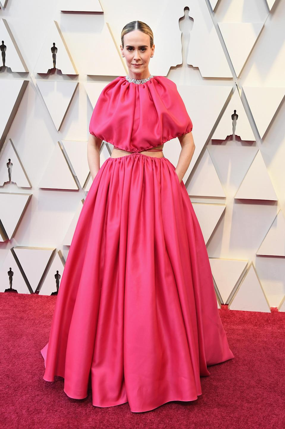 <p>Always a trendsetter, Paulson opted for a bright pink look by Brandon Maxwell that showed just a hint of skin. (Image via Getty Images) </p>