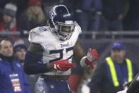 Tennessee Titans running back Derrick Henry celebrates his touchdown against the New England Patriots in the first half of an NFL wild-card playoff football game, Saturday, Jan. 4, 2020, in Foxborough, Mass. (AP Photo/Elise Amendola)