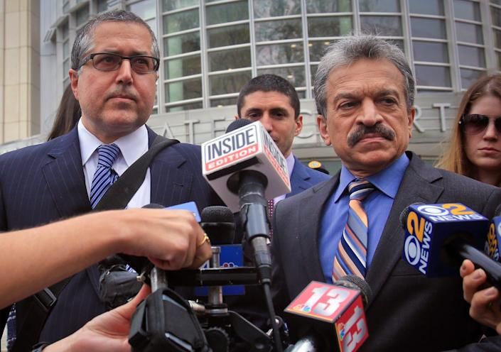 Attorneys representing NXIVM leader Keith Raniere in a sex trafficking case, Mark Agnifilo, second from left, and Paul DerOhannesian, second from right, prepare to hold a news briefing outside Brooklyn Federal Court.