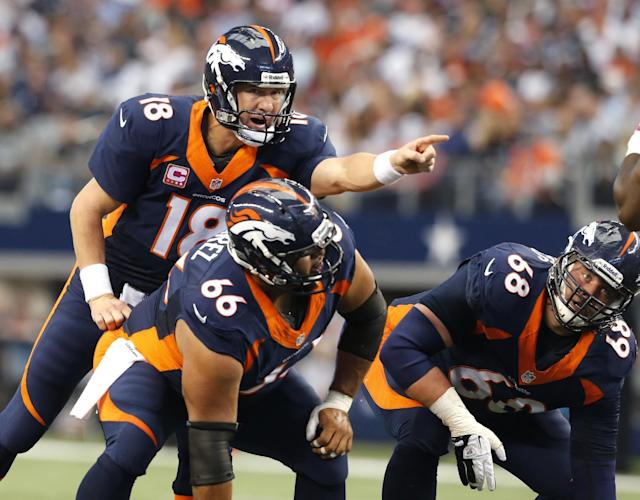 In this Oct. 6, 2013, photo, Denver Broncos quarterback Peyton Manning (18), center Manny Ramirez (66) and guard Zane Beadles (68) get ready for a play during an NFL football game against the Dallas Cowboys in Arlington, Texas. The man in the middle of Denver's offensive line, the one that's allowed the fewest sacks in the league, is the center who had never started a game at the position before this season. (AP Photo/Sharon Ellman)