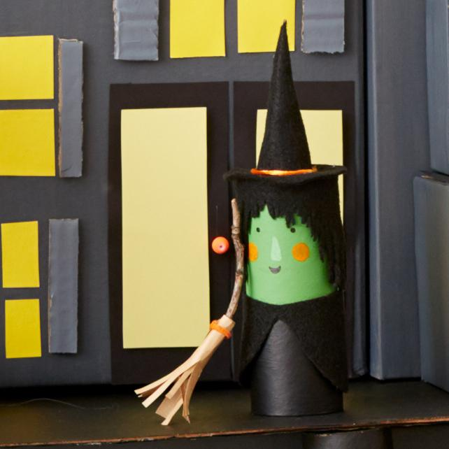 green and black witch with broom mansion of mystery