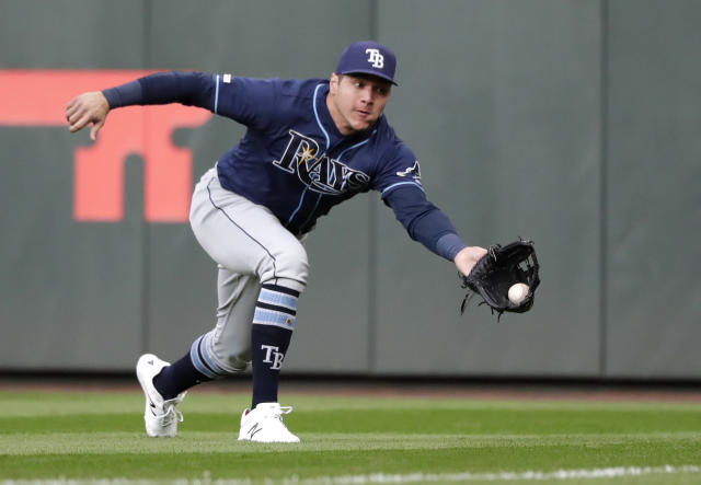 Tampa Bay Rays right fielder Avisail Garcia lunges to snag a sacrifice fly ball from Seattle Mariners' Tim Lopes that scored a run during the second inning of a baseball game Saturday, Aug. 10, 2019, in Seattle. (AP Photo/Elaine Thompson)