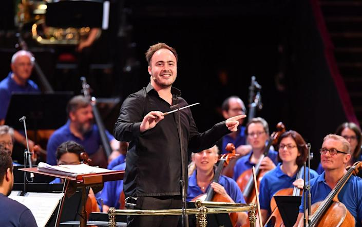 BBC Philharmonic chief guest conductor Ben Gernon with the orchestra at the Proms - Chris Christodoulou