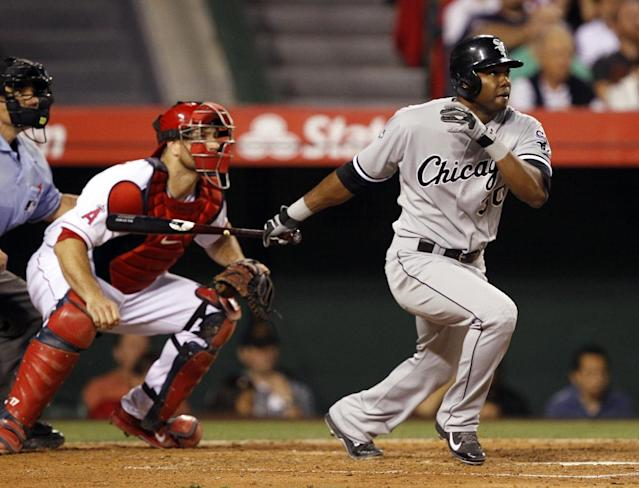 Chicago White Sox's Alejandro De Aza watches his double that scored Adam Eaton, with home plate umpire Phil Cuzzi, left, and Los Angeles Angels catcher Chris Iannetta, center, watching in the fourth inning of a baseball game Saturday, June 7, 2014, in Anaheim, Calif. (AP Photo/Alex Gallardo)