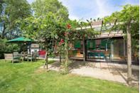 "<p>For a family-sized Cotswolds Airbnb rental with wow factor, look no further than this stunning holiday home with an array of nooks to keep everyone happy. It's just five minutes from the Cotswolds' foodie village Kingham. Step inside and you'll be seriously impressed – the eye-catching artwork, the studio annexe for teens who want their own space and the quirky living space. It's one seriously cool cottage.</p><p><strong>Sleeps:</strong> 14</p><p><strong>Price per night: </strong>£380</p><p><a class=""link rapid-noclick-resp"" href=""https://www.airbnb.co.uk/rooms/19832056"" rel=""nofollow noopener"" target=""_blank"" data-ylk=""slk:MORE DETAILS"">MORE DETAILS</a></p>"