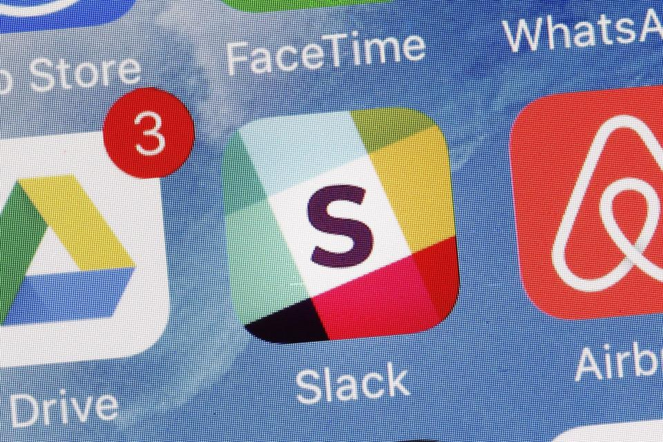 "The Slack app is displayed on a mobile phone, Tuesday, Jan. 31, 2017, in New York. Slack Technologies is hoping to convert more big businesses to its online business messaging service by making it easier for workers in different departments to communicate with each other. The new option, called ""Enterprise Grid,"" represents another major step in Slack's attempt to get more workers and employers to lessen their dependence on conventional email and embrace its service instead. (AP Photo/Mark Lennihan)"