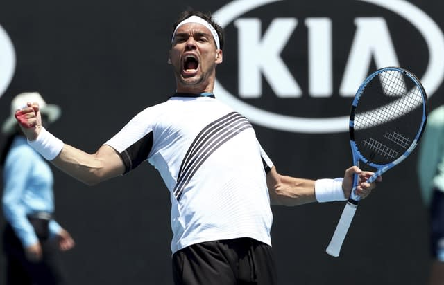 Fabio Fognini celebrates after coming from two sets down to beat Reilly Opelka (Dita Alangkara/AP)