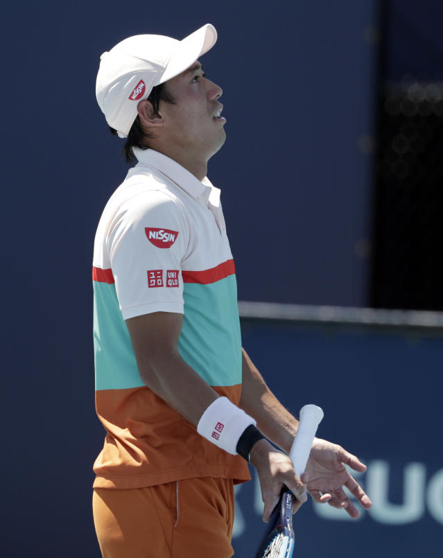 Kei Nishikori, of Japan, reacts after being broken by Dusan Lajovic, of Serbia, during the Miami Open tennis tournament, Friday, March 22, 2019, in Miami Gardens, Fla. (AP Photo/Lynne Sladky)