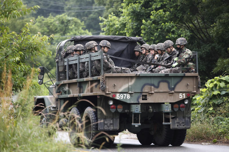 South Korean army soldiers ride on the back of a truck in Paju, South Korea, near the border with North Korea, Friday, June 19, 2020. South Korea said Thursday it hasn't detected any suspicious activities by North Korea, a day after it threatened with provocative acts at the border in violation of a 2018 agreement to reduce tensions. (AP Photo/Ahn Young-joon)