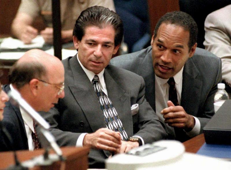"LOS ANGELES, CA - MAY 3: This 03 May, 1995 file photo shows murder defendant O.J. Simpson (R) consulting with friend Robert Kardashian (C) and Alvin Michelson (L), the attorney representing Kardashian, during a hearing in Los Angeles. It was announced 02 October, 2003 that Kardashian, a businessman and lawyer who was a key figure in the O.J. Simpson saga and part of his legal ""dream team,"" has died in Los Angeles from cancer of the esophagus. He was 59 years old. (Photo credit should read VINCE BUCCI/AFP via Getty Images)"