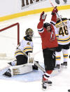 New Jersey Devils left wing Miles Wood (44) celebrates his goal as Boston Bruins goaltender Jaroslav Halak (41) reacts during the first period of an NHL hockey game Saturday, Jan. 16, 2021, in Newark, N.J. (AP Photo/Bill Kostroun)