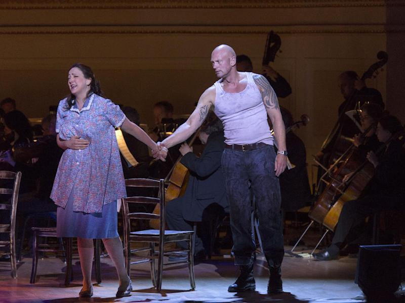 """This March 14, 2013 publicity photo provided by Carnegie Hall shows Susanna Phillips, Soprano as Stella Kowalski, left, and Teddy Tahu Rhodes, Baritone as Stanley Kowalski, in a scene from Andre Previn's , """"A Streetcar Named Desire,"""" in the Stern Auditorium, at Carnegie Hall in New York. (AP Photo/Carnegie Hall, Richard Termine)"""