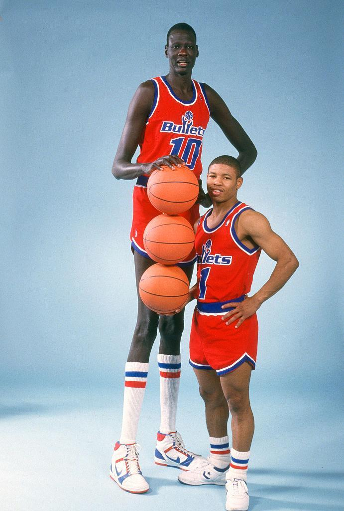 Muggsy Bogues and Manute Bol played one season together on the Washington Bullets. (Getty Images)