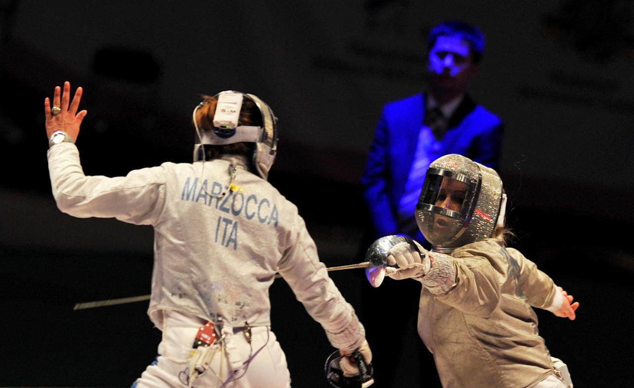Mariel Zagunis (R) of the US fights with Italy's Gioia Marzocca  during the match for Bronze of the Women's Team Sabre competition at the 2012 World Fencing Championships in Kiev on April 13, 2011. USA womens team won the Bronze medals of the championship.   AFP PHOTO/ SERGEI SUPINSKY (Photo credit should read SERGEI SUPINSKY/AFP/Getty Images)