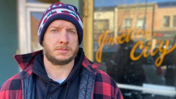 Ben Wilkinson stands in front of the live music venue, Junction City Music Hall, he and his brother opened in 2014. They are now in the process of losing the business due to COVID-19.