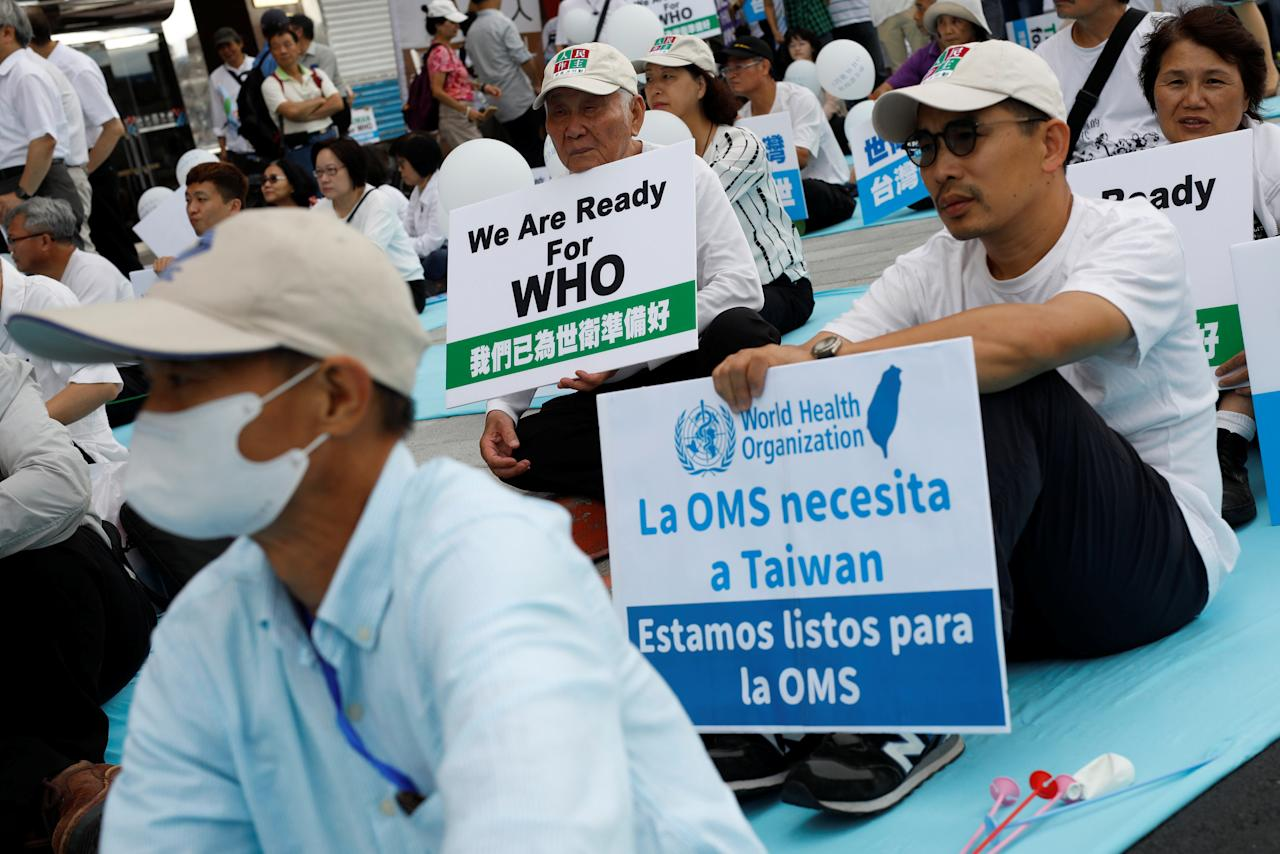 Protesters take part in a rally in Taipei against Taiwan being excluded from U.N.'s annual World Health Assembly (WHA) in Geneva, Taiwan May 21, 2017. REUTERS/Tyrone Siu