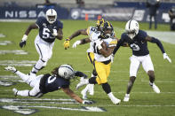 Iowa running back Mekhi Sargent (10) breaks a tackle attempt by Penn State safety Jonathan Sutherland (0) during the first quarter of an NCAA college football game in State College, Pa., on Saturday, Nov. 21, 2020. (AP Photo/Barry Reeger)