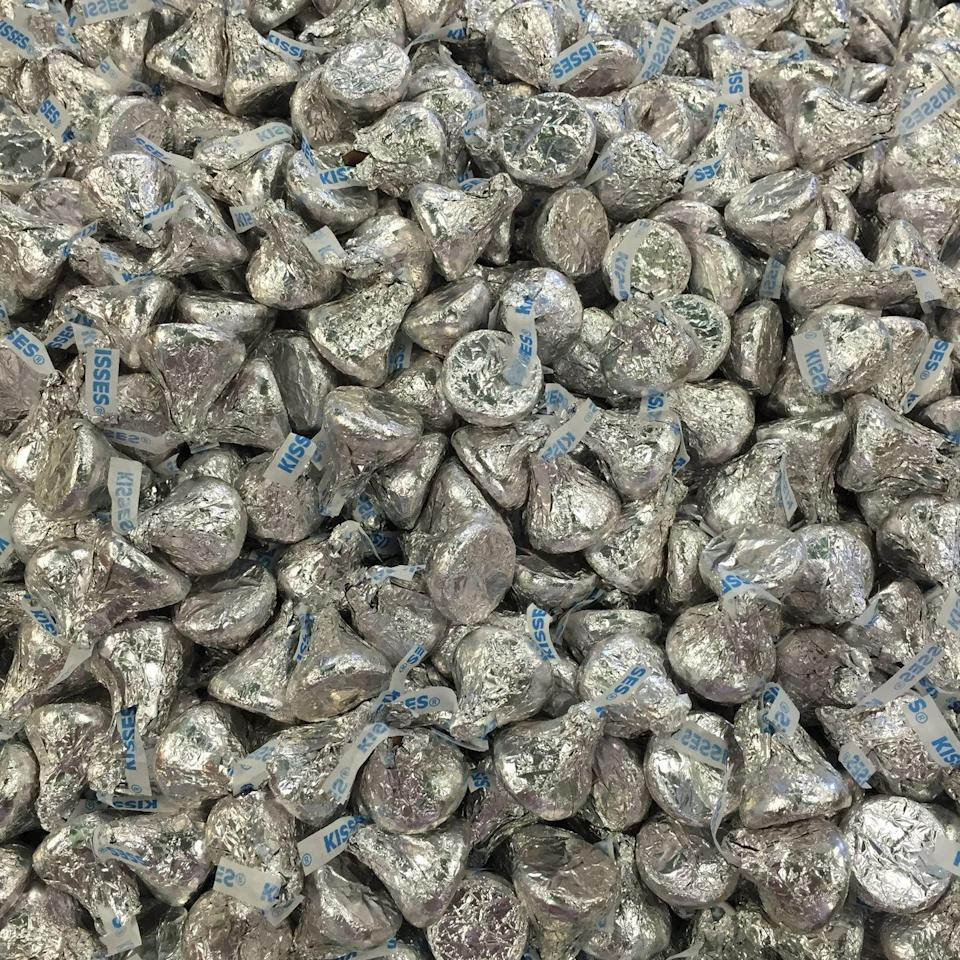 """<p><a href=""""/food-news/a50773/facts-about-hersheys-chocolate/"""" data-ylk=""""slk:Hershey's"""" class=""""link rapid-noclick-resp"""">Hershey's</a> flagship chocolate-making facility in Hershey, PA churns out 70 million foil-wrapped Kisses every day.</p>"""