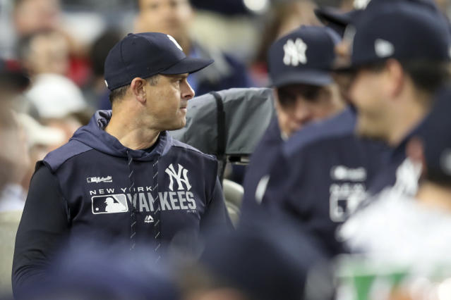 New York Yankees manager Aaron Boone watches the game action against the Los Angeles Angels during the eighth inning of a baseball game Thursday, Sept. 19, 2019, in New York. (AP Photo/Mary Altaffer)