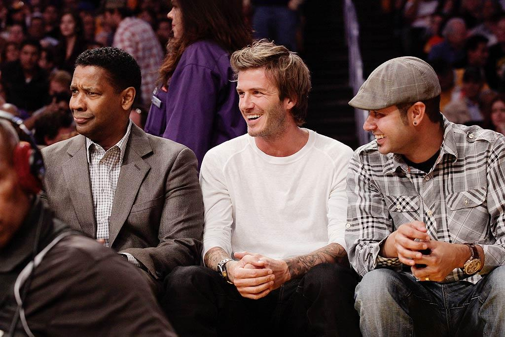 "A-listers Denzel Washington, David Beckham, and more sat courtside at the first Los Angeles Lakers game of the regular season at Staples Center. These guys are dedicated fans: Denzel managed to attend both his team's big night and the red carpet premiere of his film, ""Unstoppable,"" in the same suit! Noel Vasquez/<a href=""http://www.gettyimages.com/"" target=""new"">GettyImages.com</a> - October 26, 2010"
