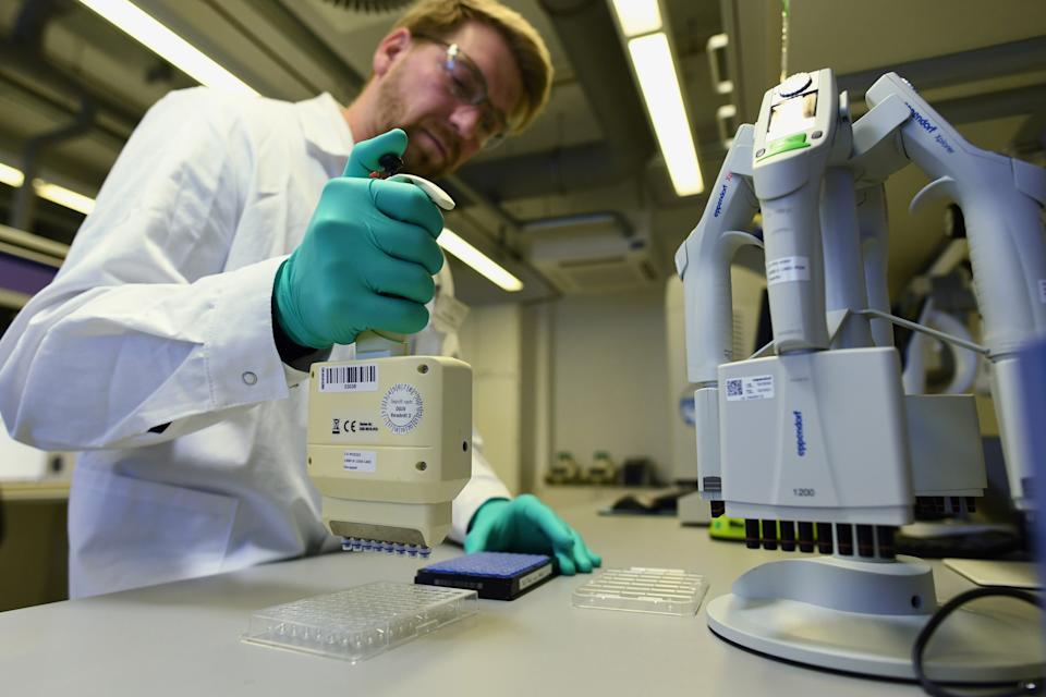 Employee Philipp Hoffmann, of German biopharmaceutical company CureVac, demonstrates research workflow on a vaccine for the coronavirus (COVID-19) disease at a laboratory in Tuebingen, Germany, March 12, 2020. Picture taken on March 12, 2020. REUTERS/Andreas Gebert