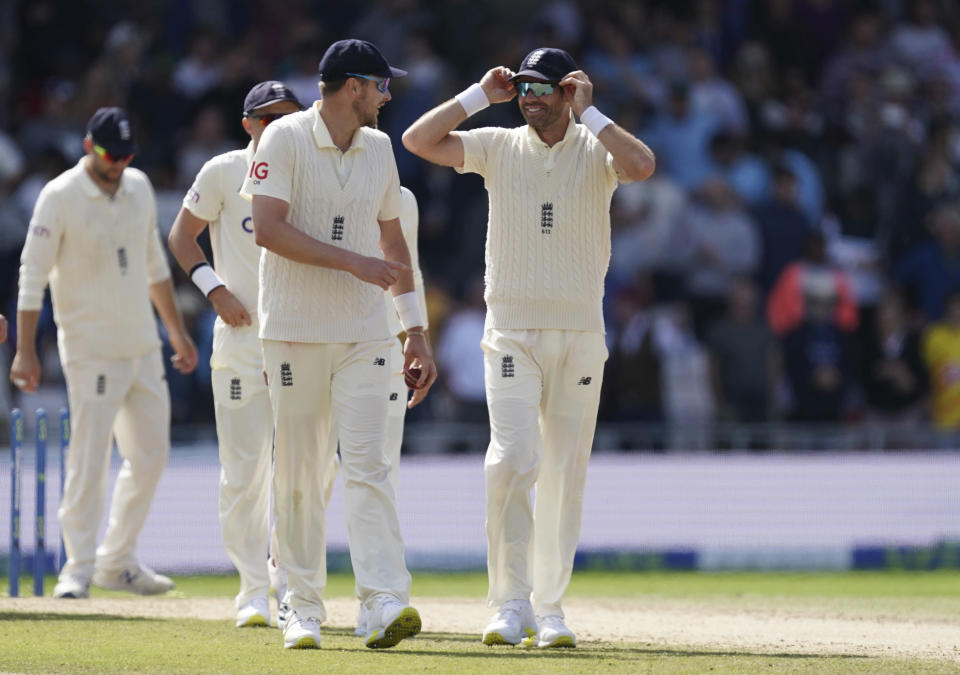 England's James Anderson, right, interacts with teammate Ollie Robinson as they walk off the field after their win on the fourth day of third test cricket match between England and India, at Headingley cricket ground in Leeds, England, Saturday, Aug. 28, 2021. (AP Photo/Jon Super)