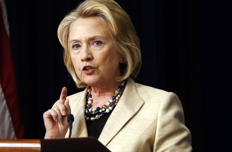 Former U.S. Secretary of State Hillary Clinton talks about Syria during an event at the White House in Washington