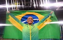 <p>Brazil's Rebeca Andrade raises her flag with pride after winning gold in the vault event of the artistic gymnastics women's vault final at the Ariake Gymnastics Centre on August 1.</p>