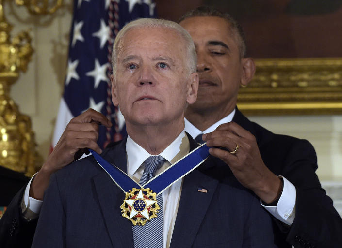 Vice President Joe Biden is emotional as President Barack Obama presents him with the Presidential Medal of Freedom during a ceremony at the White House, Jan. 12, 2017.