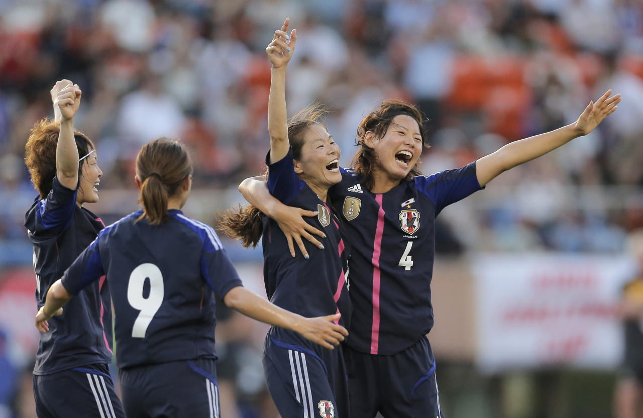 Japan's Homare Sawa, second from right, celebrates after scoring their side's  goal with teammates, Saki Kumagai (4), Nahomi Kawasumi (9) and Yuki Ogimi, left, against Australia during their friendly women's soccer match in Tokyo, Wednesday, July 11, 2012. (AP Photo/Shizuo Kambayashi)