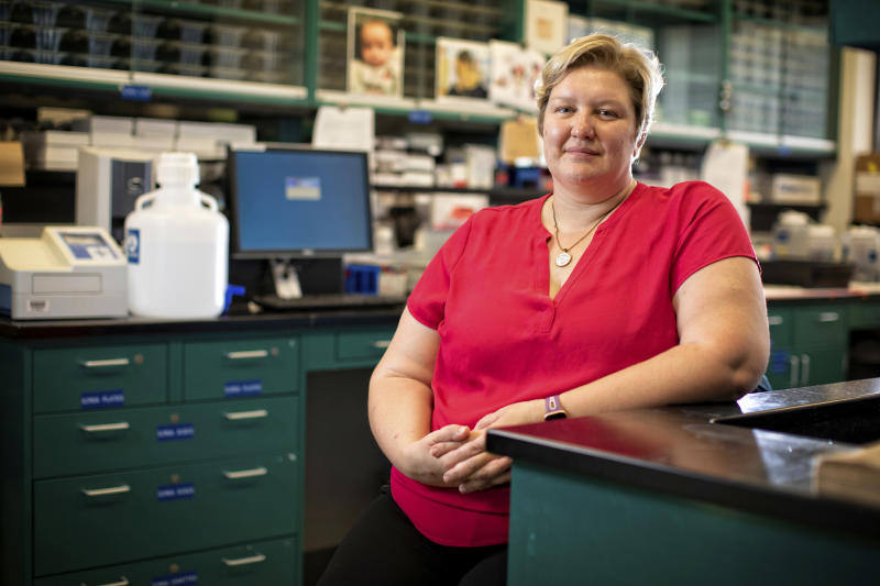 "This Aug. 14, 2019 photo provided by the University of Kentucky shows Donna Wilcock, of the Sanders-Brown Center on Aging in her lab in Lexington, Ky. She says that contrary to popular perception, ""there are a lot of changes that happen in the aging brain that lead to dementia in addition to plaques and tangles."" (Mark Cornelison/University of Kentucky via AP)"