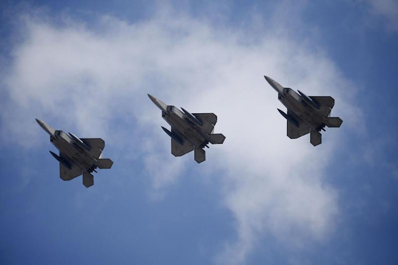 U.S. F-22 stealth fighter jets fly over Osan Air Base in Pyeongtaek, South Korea, February 17, 2016. REUTERS/Kim Hong-Ji TPX IMAGES OF THE DAY