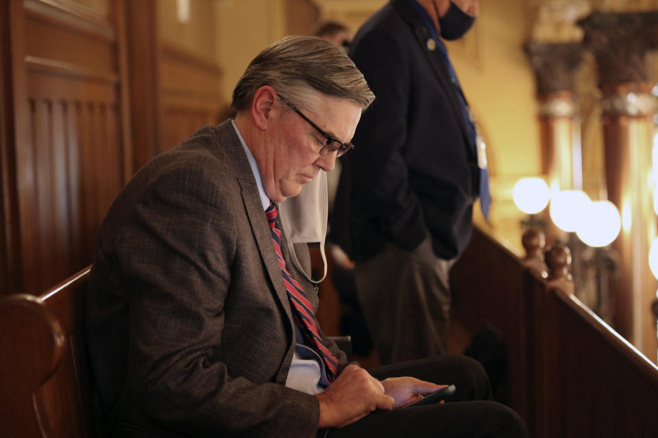 Chuck Weber, a lobbyist for the Kansas Catholic Conference, follows a state Senate debate on a proposed anti-abortion amendment to the state constitution from a Senate gallery, Thursday, Jan. 28, 2021, in Topeka, Kan. The proposed amendment would overturn a Kansas Supreme Court decision protecting abortion rights. (AP Photo/John Hanna)