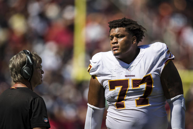 LANDOVER, MD - SEPTEMBER 15: Ereck Flowers #77 of the Washington Redskins speaks with assistant head coach and offensive line coach Bill Callahan during the first half of the game against the Dallas Cowboys at FedExField on September 15, 2019 in Landover, Maryland. (Photo by Scott Taetsch/Getty Images)