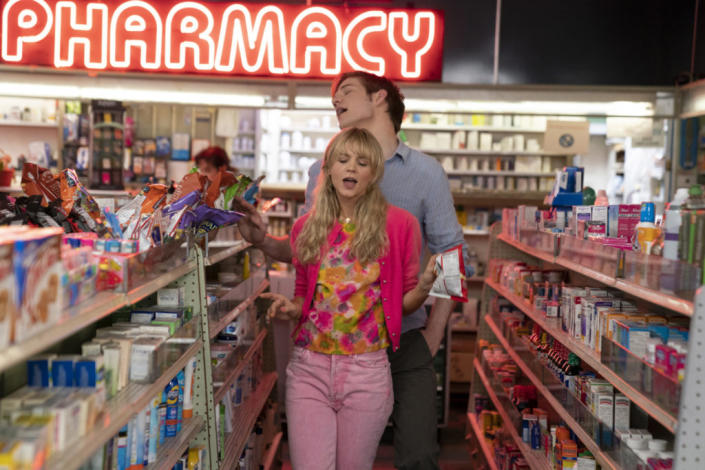 Carey Mulligan sings in a drugstore in a scene from Promising Young Woman.  Image via focus functions