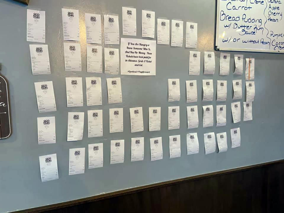 In this Feb. 5, 2021, photo provided by Zack's Cafe, receipts for pre-paid meals hang on the wall inside Zack's Cafe in Miami, Okla. Customers pay for them so that people in need, many of them struggling financially due to the coronavirus pandemic, can get a meal, judgment-free and no questions asked. (Zack's Cafe via AP)