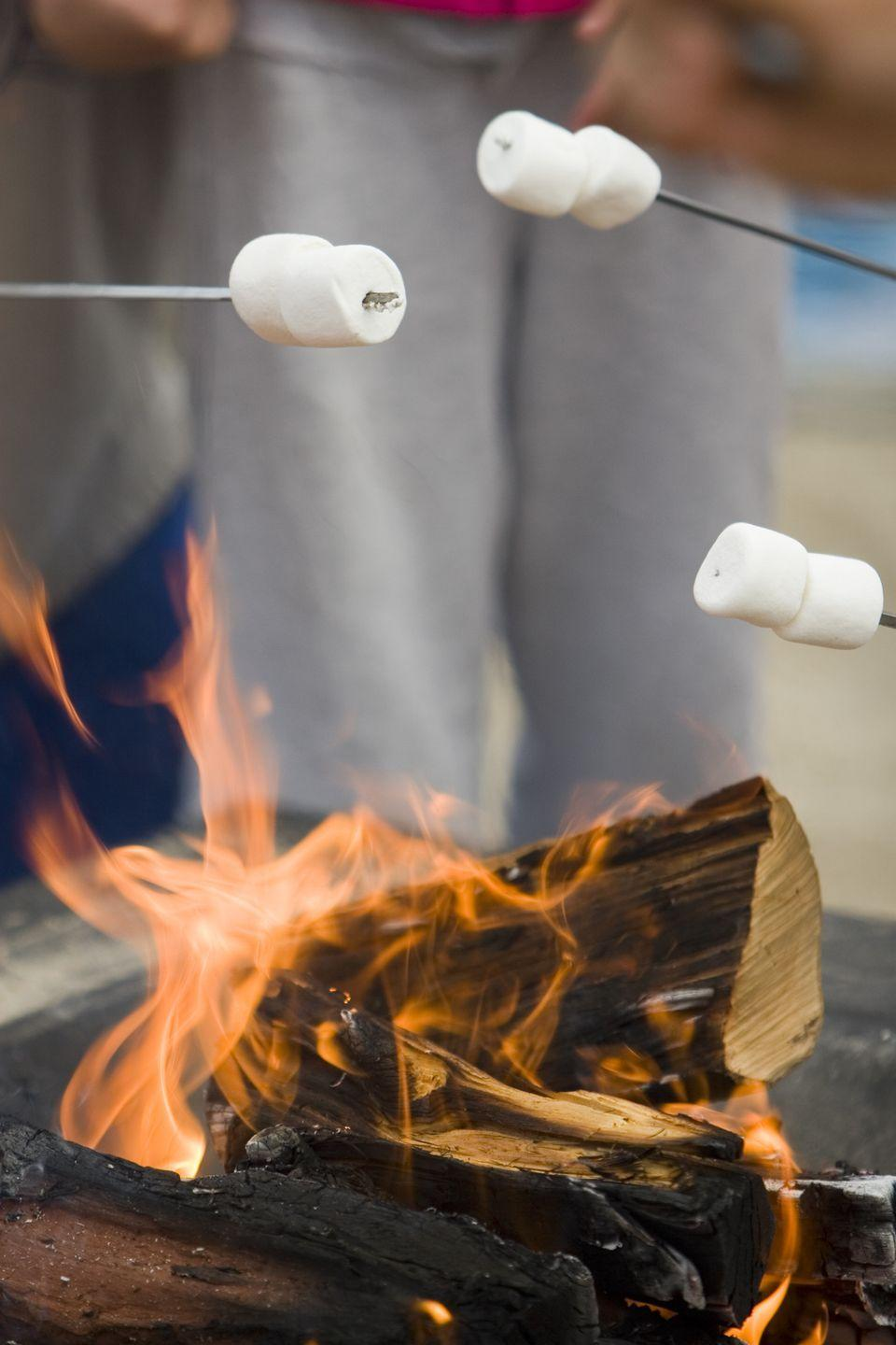 """<p>Why are scary stories so much more frightening when told around a campfire? This Halloween, cook up some s'mores and ask everyone to come prepared to share their favorite spooky tale.</p><p><a class=""""link rapid-noclick-resp"""" href=""""https://www.amazon.com/Fire-Pits-Outdoor-Wood-Burning/dp/B0137QZ1Q6/ref=sr_1_2_sspa?tag=syn-yahoo-20&ascsubtag=%5Bartid%7C10072.g.28787574%5Bsrc%7Cyahoo-us"""" rel=""""nofollow noopener"""" target=""""_blank"""" data-ylk=""""slk:SHOP FIRE PITS"""">SHOP FIRE PITS</a></p>"""