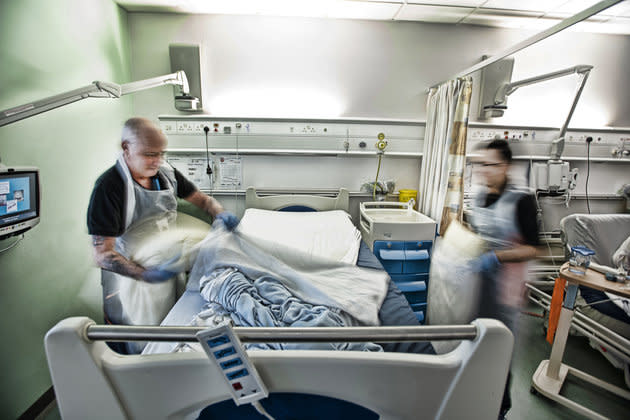 Robert Sharp and Mohammed Patel, the bed-making team, clean beds thoroughly between patients