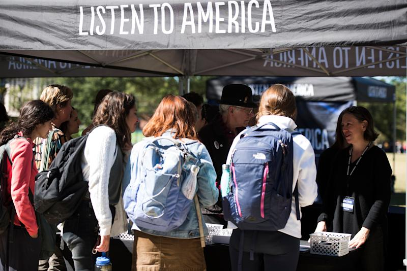 Passers-by stop by the Listen to America tents while HuffPost visits  Tulane University in New Orleans on Oct. 30.
