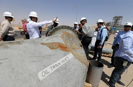 A damaged pipeline is seen at Saudi Aramco oil facility in Khurais