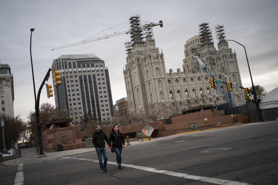 The Salt Lake Temple of The Church of Jesus Christ of Latter-day Saints is seen under construction in Salt Lake City, Sunday, Nov. 15, 2020. While the church has traditionally been overwhelmingly conservative and Republican, today there's also an increasingly large strain of liberal members. The church has also begun to directly address its history of racism, including a ban on Black priests that it lifted four decades ago. (AP Photo/Wong Maye-E)