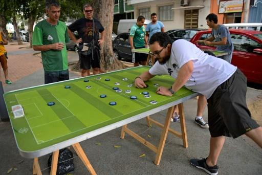 Every weekend, some 20 to 30 people meet in Rio de Janeiro to play button football -- with their customized colorful buttons, inspired by teams around the world and legendary players