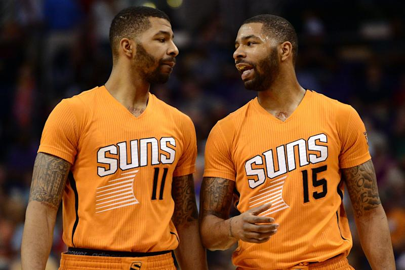 Marcus Morris (15), at right, shown here on March 27, 2015, had his twin brother Markieff Morris (11) as a teammate for a time on the Phoenix Suns.