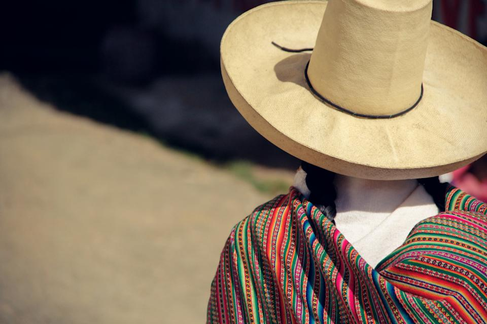 Andean woman with hat and cloak