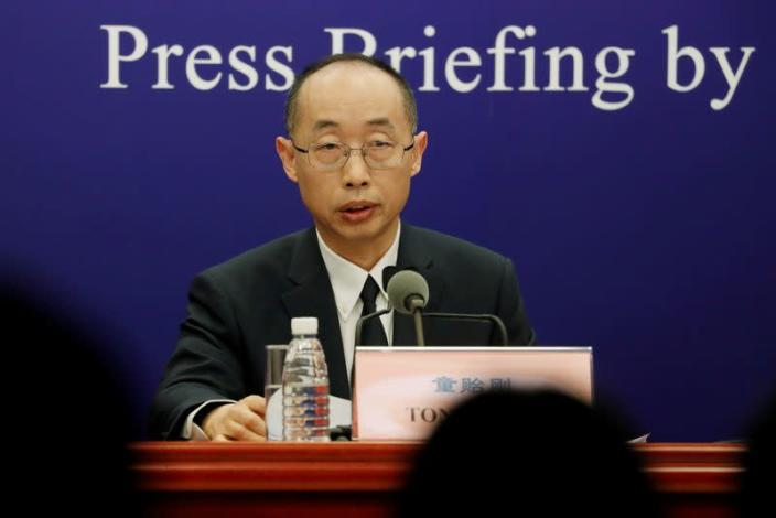 FILE PHOTO: Tong Yigang at a news conference on the WHO-China joint study, in Beijing