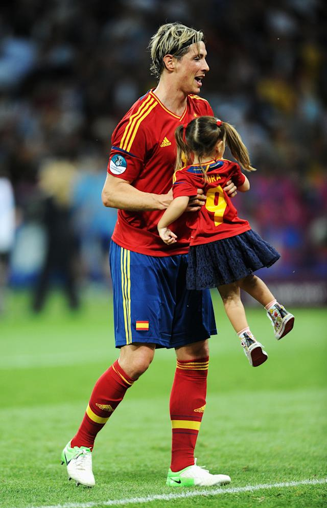 KIEV, UKRAINE - JULY 01: Fernando Torres of Spain picks up his daughter Nora Torres after the UEFA EURO 2012 final match between Spain and Italy at the Olympic Stadium on July 1, 2012 in Kiev, Ukraine. (Photo by Jasper Juinen/Getty Images)