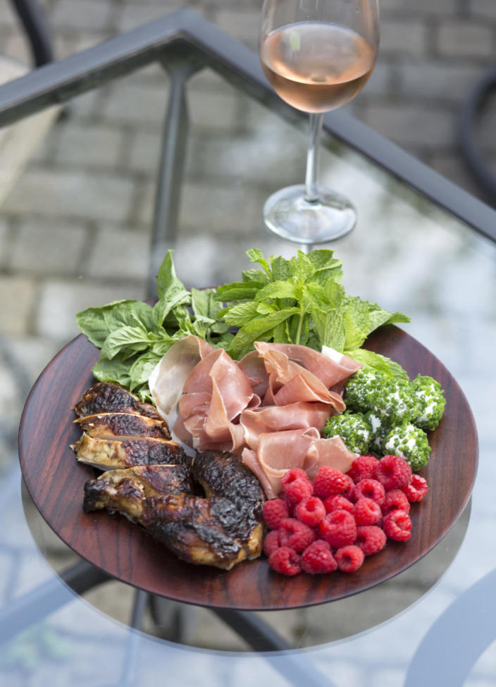 """<p>For the meat lover who enjoys an elegant twist. Combine pre-cooked chicken with cured meats, bring in a tupperware of raspberries and herbs and for the final flourish, add balls of goats cheese you have pre-rolled in chives. Full recipe is available in <a href=""""http://www.amazon.com/Lemon-Salt-Modern-Culinary-Revelry/dp/0692372857/ref=sr_1_1?ie=UTF8&qid=1458141598&sr=8-1&keywords=ashton+keefe"""" rel=""""nofollow noopener"""" target=""""_blank"""" data-ylk=""""slk:Lemon & Salt: A Modern Girl's Guide to Culinary Revelry"""" class=""""link rapid-noclick-resp"""">Lemon & Salt: A Modern Girl's Guide to Culinary Revelry</a>. <i>[Photo: Ashton Keefe]</i></p>"""