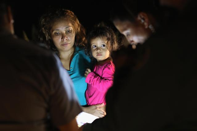 <p>Central American asylum seekers, including a Honduran girl, 2, and her mother, are taken into custody near the U.S.-Mexico border on June 12, 2018 in McAllen, Texas. (Photo: John Moore/Getty Images) </p>